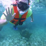 Aaron Douglas waving after snorkeling in Cancun